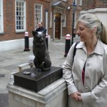 """<font size=""""1"""">Bonnie with a sculpture of Samuel Johnson's cat, Hodge, who watches over Gough Square in London and gazes across to Johnson's house at #17. He perches on a copy of Johnson's dictionary. At his feet lie the empty shells of two oysters, his favorite food.</font>"""